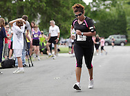Middletown, New York - A runners heads for the finish line in the 15th annual Ruthie Dino Marshall 5K Run and Fun Walk hosted by the Middletown YMCA on Sunday, June 5,  2011.