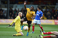 Lenell John-Lewis of Newport county © is denied by Portsmouth goalkeeper Aaron McCarey .Skybet football league two match, Newport county v Portsmouth at Rodney Parade in Newport, South Wales  on Saturday 17th October 2015.<br /> pic by  Andrew Orchard, Andrew Orchard sports photography.