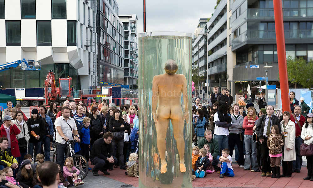 Award winning choreographer Jess Curtis performing Noustube, part of Equilibre, naked in a clear cylinder of water at Grand Canal Square during the Dublin Fringe Festival.