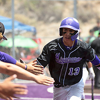 Miyamura Patriot Isaiah Martinez high fives his teammates after stealing home to earn Miyamura's first run against Albuquerque Academy in the NMAA Baseball State Championship semifinal game Thursday in Gallup.