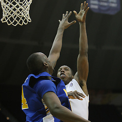 Jan 04, 2010; Baton Rouge, LA, USA;  LSU Tigers forward Tasmin Mitchell (1) shoots over McNeese State Cowboys forward Jamarcus Little (14) during the second half at the Pete Maravich Assembly Center. LSU defeated McNeese State 83-60.  Mandatory Credit: Derick E. Hingle-US PRESSWIRE