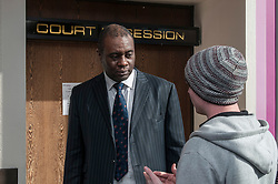 Defendant outside court speaking to the duty solicitor