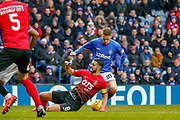 Steven Davis of Rangers avoids the challenge from Gary Dicker of Kilmarnock during the Ladbrokes Scottish Premiership match between Rangers and Kilmarnock at Ibrox, Glasgow, Scotland on 16 March 2019.