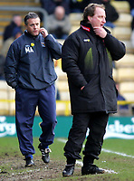 Photo:  Frances Leader.<br /> Watford v Coventry City. Coca Cola Championship. <br /> Vicarage Road Stadium<br /> 05/03/2005<br /> Coventry's manager Micky Adams and Watford's manager Ray Lewington both look tense on the side lines.