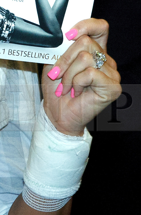 © licenced to London News Pictures. Peterborough, UK 07/05/2011.Katie Price has been spotted wearing a diamond ring on her engagement finger.  She also wore a bandage on her left wrist. Katie Price/Jordon at a book signing at Waterstones in Peterborough. Photo credit should read Jason Patel/LNP. Please see special instructions.