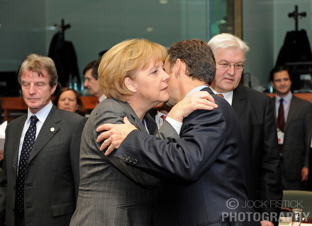 Angela Merkel, Germany's chancellor, left, is greeted by Nicolas Sarkozy, France's president, during the second day of the European Summit, in Brussels, Belgium, Friday, Dec. 12, 2008. (Photo © Jock Fistick)