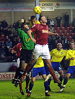 Photo: Dave Linney.<br />Walsall v Colchester United. Coca Cola League 1.<br />14/01/2006.<br />Colchester's keeper Aiden Davison (L)<br />punches clear before Anthony Gerrard (C) can get to the ball.