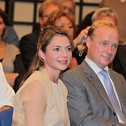 """NLD/Den Haag/20110912 - Boekpresentatie Annemarie Gualtherie van Weezel """" De Smaak van de Macht"""", Prins Carlos Xavier Bourbon de Parma en partner Annemarie Gualthérie van Weezel"""