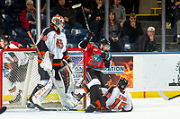 KELOWNA, BC - NOVEMBER 8:  Kobe Mohr #25 of the Kelowna Rockets and Dru Krebs #15 crash into the net of Mads Søgaard #30 of the Medicine Hat Tigers defends the net against the Kelowna Rockets at Prospera Place on November 8, 2019 in Kelowna, Canada. (Photo by Marissa Baecker/Shoot the Breeze)