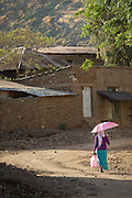 Woman with umbrella, Axum. Tigray region. Ethiopia, Horn of Africa