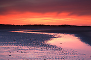 Low tide reflections at dusk, Brancaster Beach, North Norfolk, East Anglia.