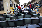 TVs lined up, most of them has just been off-loaded from  a container from the UK. Some of the TVs, if not all, are  non-funtioning.  Alaba International Market, one of the largest markets for electronic goods in West Africa.  New and old - and a lot of non-working electronic goods such as TVs and computers come in to the market via Lagos harbour from the US, Western Europe and China.This picture is part of an undercover investigation by Greenpeace and Sky News.  A TV-set originally delivered to a municipality-run collecting point in UK for discarded electronic products was tracked and monitored by Greenpeace using a combination of GPS, GSM, and an onboard radiofrequency transmitter placed inside the TV-set.  The TV arrived in Lagos in container no 4629416 and was found in Alaba International Market and bought back by Greenpeace activist. The TV was subsequently brought back to England and used as proof of illegal export of electronic waste. A number of individual are currently on trial in London in connection with illegal exports(Nov 2011)