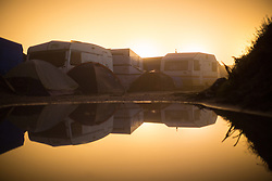 """© Licensed to London News Pictures . 23/10/2016 . Calais , France . Dawn at the Calais migrant camp known as """" The Jungle """" , in Northern France , on the final day before the eviction and destruction of the camp . Photo credit: Joel Goodman/LNP"""