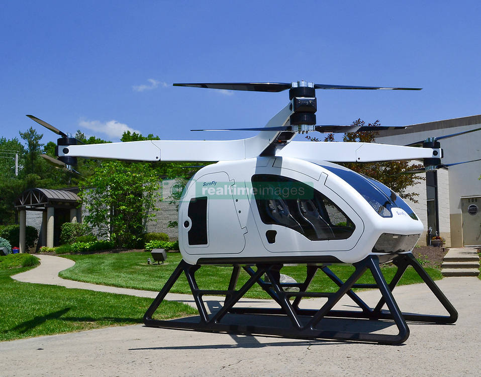 "June 6, 2017 - inconnu - Here's a hybrid helicopter the makers hope will one day be capable of carrying commuters to work –without a pilot.The electric-powered SureFly has been designed to carry two passengers on journeys up to 70 miles / 112 kilometres.Early models will be pilot-operated, but the goal is to introduce future models featuring autonomous flight capable of carrying payloads of up to 400 pounds / 180 kg. The helicopter also features an eight-armed layout, similar to those found in some models of drones.Each of the four propeller arms holds two fixed propellers that rotate in opposite directions, which would allow the helicopter to reach higher speeds and achieve greater efficiency.The propellers will fold down to allow for more easy storage.It will also include a backup battery to drive the electric motors in the event of engine failure and a ballistic parachute that safely brings down the craft if needed.Cincinnati-based US company Workhorse intends to start test flights of the concept vehicle this year and hopes to put it into mass production in late 2019.The expected price is around $200,000 USD / £155,000 GBP / €178,000 Euros price tag.Workhorse says it has reinvented the helicopter from the ground up, 78 years after the first working model took to the skies. The company has already launched a range of electric and hybrid vehicles, including drones, pickup trucks and delivery vans.The SureFly borrows design elements from this existing fleet of vehicles, to create an aircraft that the designers hope will be safer and more stable to fly, as well as being better for the environment.Workhorse believes the agricultural sector, emergency services, city commuters and the military may be among the early adopters of the technology. CO Stepehn Vurns said :""The helicopter has been around for 78 years and is finally being reinvented.""We're excited to unveil the SureFly on the world stage as we believe it represents a major ste"
