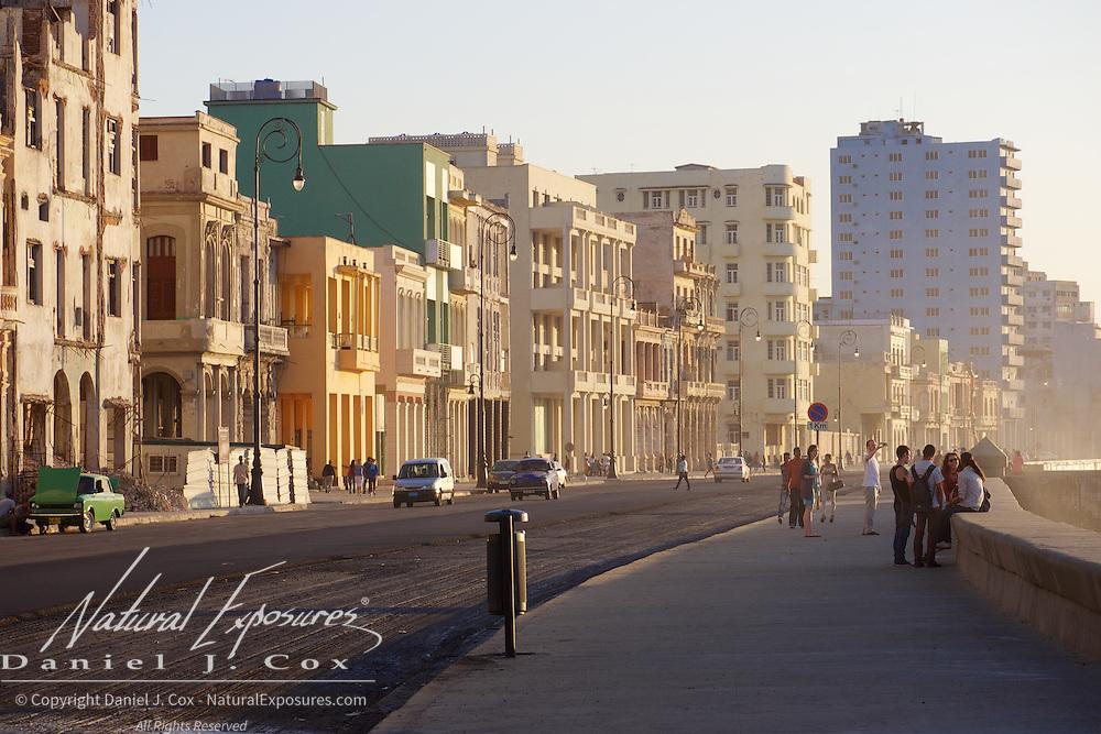 People walking along the Avenue near the Malecon, Havana, Cuba.