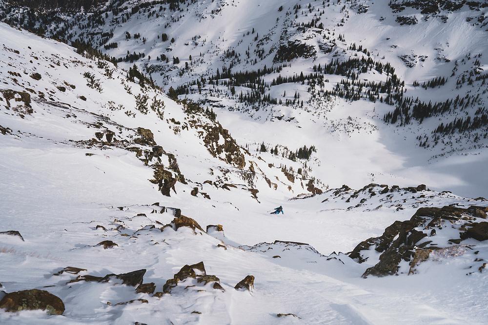 Tasty!  Mali Noyes drops onto the east face of Twin Peaks, Wasatch Range, Utah.