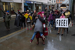 © Licensed to London News Pictures.04/01/2021, London, UK. Julian Assange's supporters celebrate the court verdict at the Old Bailey, central London, after a judgement which said that Julian Assange cannot be extradite from the UK to the US. Photo credit: Marcin Nowak/LNP