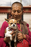 A Tibetan Buddhist pilgrim on the Barkor in Lhasa, Tibet.