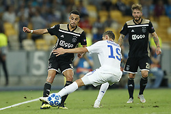 (L-R) Noussair Mazraoui of Ajax, Denys Garmash of Dynamo Kyiv, Lasse Schone of Ajax during the UEFA Champions League play offs round second leg match between Dynamo Kyiv and Ajax Amsterdam at the NSK Olimpiyskyi on August 28, 2018 in Kyiv, Ukraine
