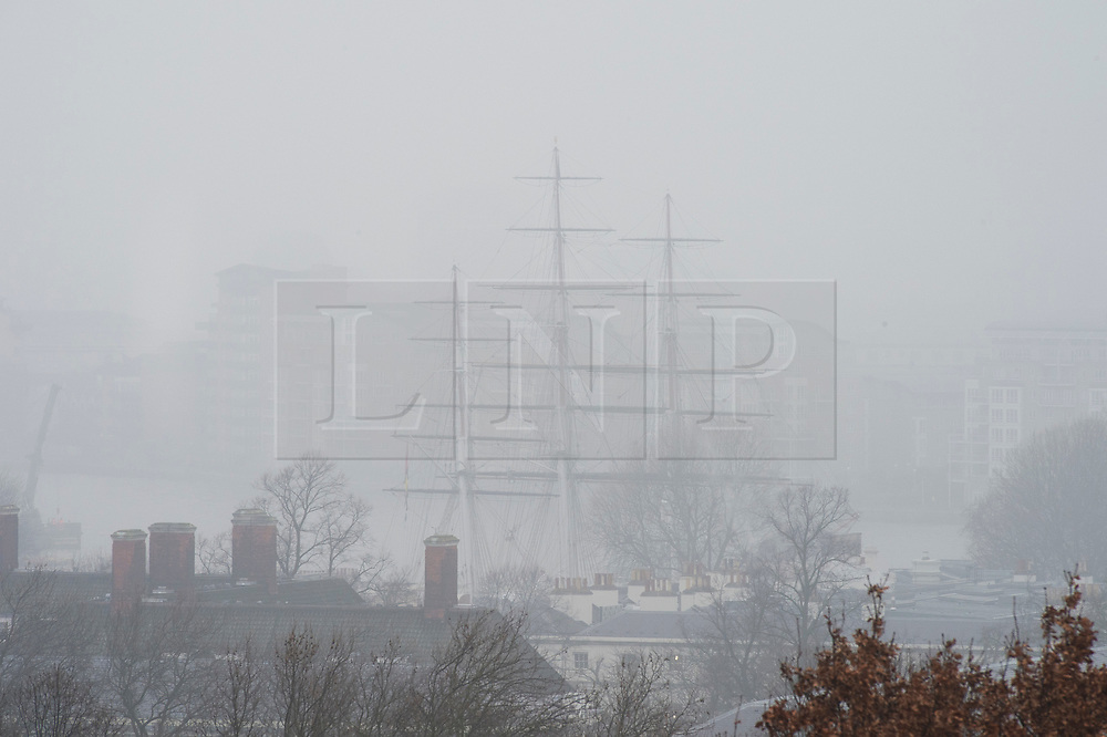 ©Licensed to London News Pictures 22/01/2020<br /> Greenwich, UK. The masts of the Cutty Sark stand out in the foggy weather, Greenwich Park, London. Freezing foggy weather conditions continue across London this afternoon. Photo credit: Grant Falvey/LNP