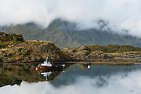 Small fishing boat at mooring, Steine, Lofoten islands, Norway