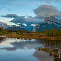 Evening Clouds float above Vermillion Lakes in Banff National Park, Alberta, Canada.  Behind is Mount Rundle.