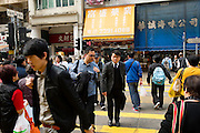 HONG KONG - MARCH 03: A crowd of people cross the street in Mong Kok busy neighborhood, on March 3, in Hong Kong. (Photo by Lucas Schifres/Pictobank)