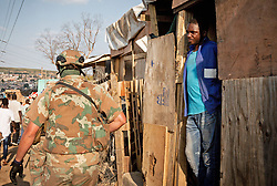 JOHANNESBURG, April 21, 2020  A man watches soldiers of South African National Defense Force patrol in Johannesburg, South Africa, April 20, 2020. South Africa's COVID-19 cases have surged to 3,300, up by 142 from the previous count, Health Minister Zweli Mkhize said Monday. (Photo by Yeshiel/Xinhua) (Credit Image: © Xinhua via ZUMA Wire)