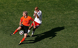 14-06-2010 VOETBAL: FIFA WORLDCUP 2010 NEDERLAND - DENEMARKEN: JOHANNESBURG<br /> Dirk Kuyt of Netherlands fliclks the ball on past Simon Poulsen of Denmark<br /> ©2010-FRH- NPH/  Mark Atkins (Netherlands only)