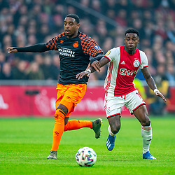 Quincy Promes #11 of Ajax and Pablo Rosario #18 of PSV Eindhoven in action during the match between Ajax and PSV at Johan Cruyff Arena on February 02, 2020 in Amsterdam, Netherlands