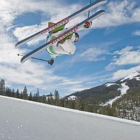 SKIING, Big Sky, Montana. Ben Wiltsie (MR) skis aerial manouvers and flips in half pipe in terrain park at Big Sky Ski Resort, near Bozeman, Montana. 11,166-foot Lone Mountain bkg.