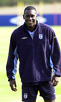 Photo. Glyn Thomas<br />England Training-prior to England v Croatia international friendly.<br />Five Lakes. 19/08/2003.<br />Emil Heskey is in relaxed mood at England training.