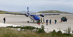 Barra Airport is a short-runway airport situated in the wide shallow bay of Traigh Mhòr at the north tip of the island of Barra in the Outer Hebrides, Scotland. Barra is now the only beach airport anywhere in the world to be used for scheduled airline services. Passengers prepare to embark aircraft. (c) Stephen Lawson   Edinburgh Elite media