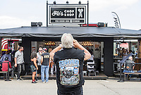 Flo's Chop Shop at the Progressive Insurance booth was seeing a brisk business on Thursday afternoon offering boot shines, shaves and manicures for bikers on Lakeside Avenue.  (Karen Bobotas/for the Laconia Daily Sun)