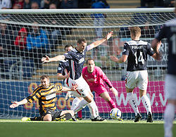 Falkirk's David McCracken brings down Alloa Athletic's Holmes for their penalty.<br /> half time : Falkirk 1 v 1 Alloa Athletic, Scottish Championship game played 4/10/2014 at The Falkirk Stadium.