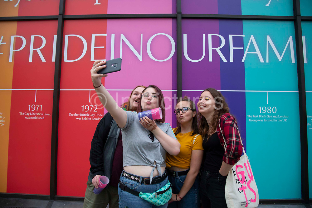 Friends take a selfie photograph as members of the Lesbian, Gay, Bisexual and Transgender (LGBT) community take part in the annual Pride Parade on 6th July, 2019 in London,United Kingdom. (photo by Claire Doherty/In Pictures via Getty Images)