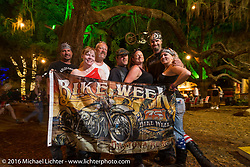 Friends from Binghampton, NY having a great time at the Broken Spoke Saloon. Daytona Bike Week 75th Anniversary event. FL, USA. Wednesday March 9, 2016.  Photography ©2016 Michael Lichter.
