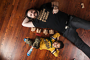 BALTIMORE, MD -- 12/22/14 -- Benjamin Jancewicz, 31, a designer from Baltimore, with his son, Arion Jancewicz, 6, talks about the complexity of being a biracial family.…by André Chung #_AC23909