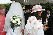 The bride (Kallah) assisted by 2 escorts holding candles circles her groom 7 times under the chuppah. There are many reasons for this, Kabbalah (the Jewish tradition of mysticism) says that women, representing the earth, re-enact seven revolutions that the earth made during the seven days of creation.