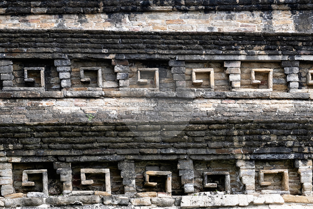 Details of decorated stone niches on Building C at the pre-Columbian archeological complex of El Tajin in Tajin, Veracruz, Mexico. El Tajín flourished from 600 to 1200 CE and during this time numerous temples, palaces, ballcourts, and pyramids were built by the Totonac people and is one of the largest and most important cities of the Classic era of Mesoamerica.