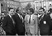 Nissan International Cycle Race..1986..01.10.1986..10.01.1986..1st October 1986..The Nissan Classic began today from Trinity College,Dublin. The offical race starter was The Taoiseach,Dr Garrett FitzGerald TD. He was accompanied by the Minister for Sport,Mr Sean Barrett TD..Sean Kelly was returning to defend his title but his opposition included Greg LeMond, the 1983 world champion and the winner of the Tour de France of the previous July. Roche was out due to his injured leg. Adri van der Poel was back with 1980 Tour de France winner and 1985 world champion Joop Zoetemelk. Teun van Vliet was back too. The winner of the green jersey of the Tour de France that July, Eric Vanderaerden was there as well as Australians Phil Anderson and Alan Peiper as well the Scottish cyclist Robert Millar...Photo shows Mr Gerard O'Toole,Managing Director,Nissan Ireland and minister for Sport,Mr Sean Barrett chatting with a Nissan race official prior to the start of the race...