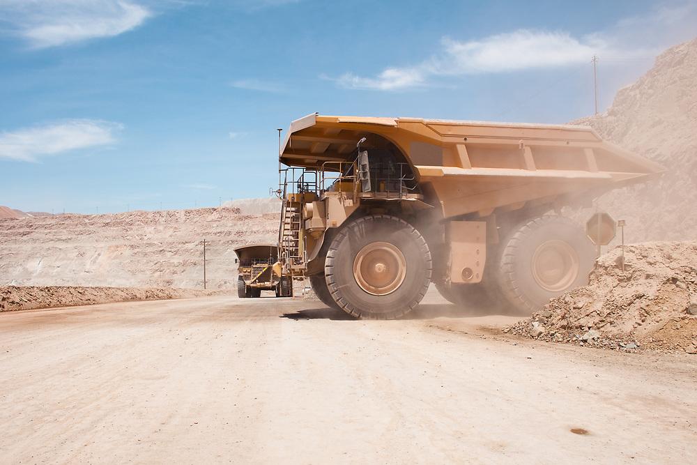 Big dump trucks at an open-pit copper mine in Peru.