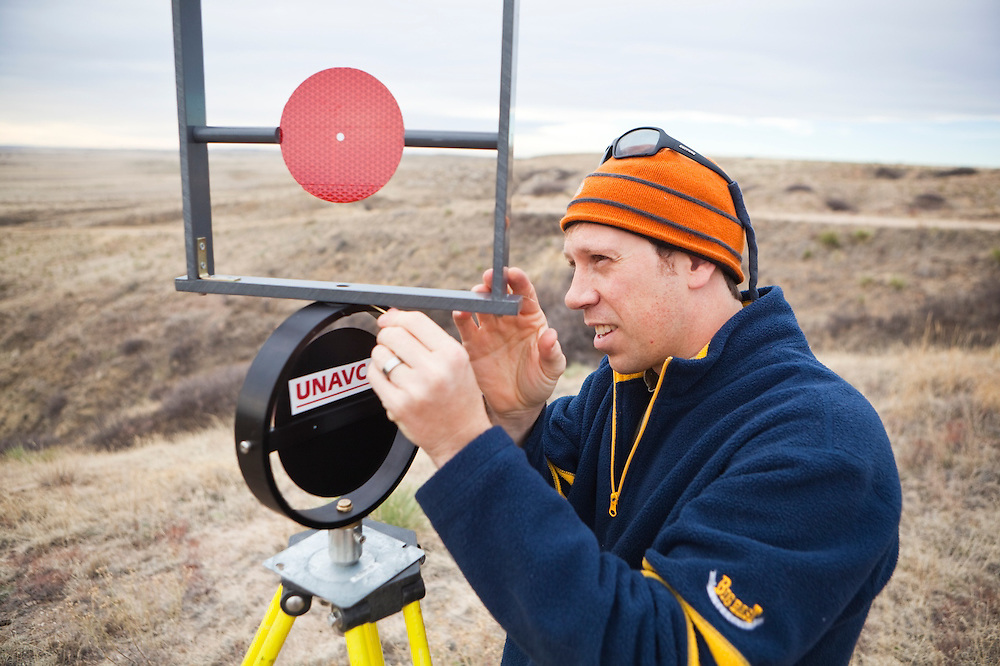 University of Colorado geology graduate student Francis Rengers installs a LiDAR laser scanning target for his research studying stream erosion at the Plains Conservation Center boundary near Strasburg, Colorado.