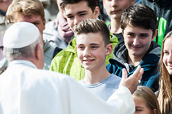 Pope Francis greats a groups of youngs during the wednesday general audience in Saint Peter's square at the Vatican.