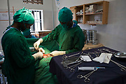 A patient is having a hernia corrected in the operating theatre at Bwindi Community Hospital, Buhoma on the edge of the Bwindi Impenetrable Forest in South-Western Uganda. It serves around 60,000 people from the surrounding area.