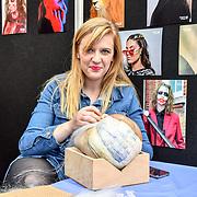 Kingston college - Teacher Megan Quilter-Price - wig making demo at IMATS London on 18 May 2019,  London, UK.