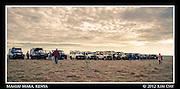Line of Land Rovers Waiting for Mass Of Chinese Tourists.Maasai Mara, Kenya.September 2012