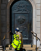 Masked as people pass the Bank of England - Anti Coronavirus (Covid 19) outbreak in London.
