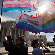 Shannon Glatz, left, and her partner, Liberty Manos along with Alex Rangel, of Get Equal, demonstrated near the steps of the Supreme Court during the hearings about the constitutionality of the Defense of Marriage Act (DOMA) on Wednesday, March 27, 2013.  Glatz and Manos were married en masse in front of the Supreme Court on June 21, 2013. John Boal Photography.