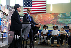 """President Barack Obama is interviewed by 6th-grader Osman Yaya during the """"Of the People: Live from the White House"""" Virtual Field Trip series, at the Anacostia Neighborhood Library in Washington, D.C., April 30, 2015. (Official White House Photo by Chuck Kennedy)<br /> <br /> This official White House photograph is being made available only for publication by news organizations and/or for personal use printing by the subject(s) of the photograph. The photograph may not be manipulated in any way and may not be used in commercial or political materials, advertisements, emails, products, promotions that in any way suggests approval or endorsement of the President, the First Family, or the White House."""